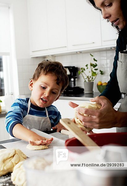 Mother and son baking Sweden.
