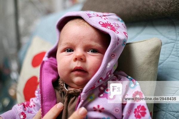 Baby wearing a purple flowered sweater  Toronto  Ontario