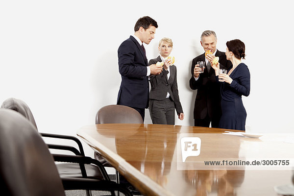 Four businesspeople in conference room  Bavaria  Germany