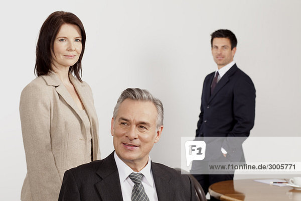 Three businesspeople in conference room  Bavaria  Germany