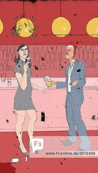 Mann flirtet mit Frau auf Weihnachtsfeier