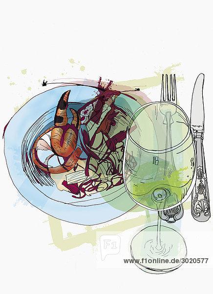 Teller mit Meeresfrüchten und ein Glas Weißwein