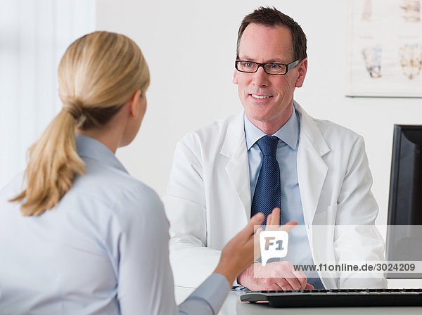 Woman talking to a doctor