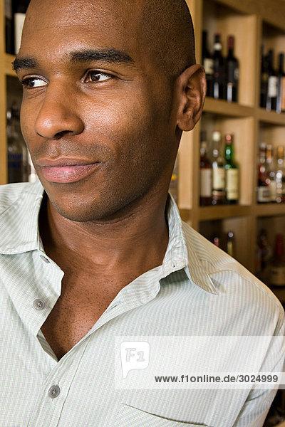 An african american man in a bar