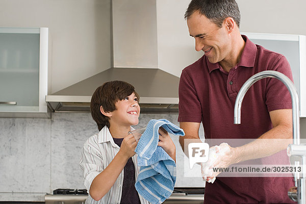 Father and son washing up