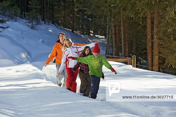 Austria,  Salzburger Land,  Altenmarkt,  Family walking in snow