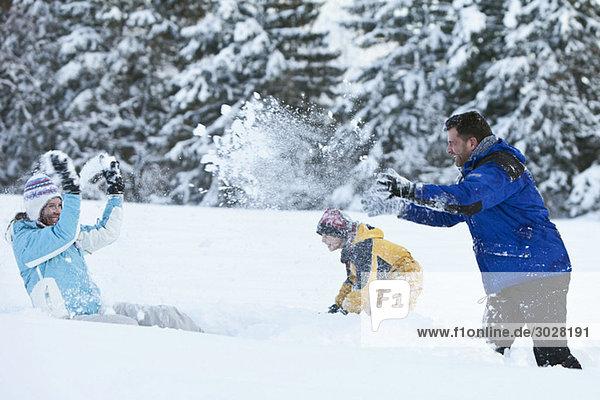 Germany  Bavaria  Family having snowball fight