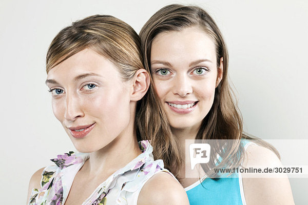 Two young women smiling  portrait