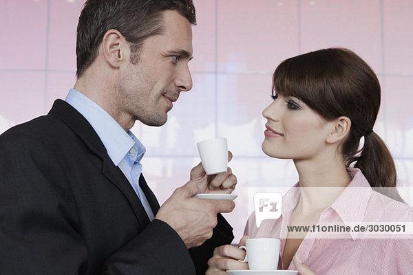 Germany  Cologne  Couple drinking espresso  portrait