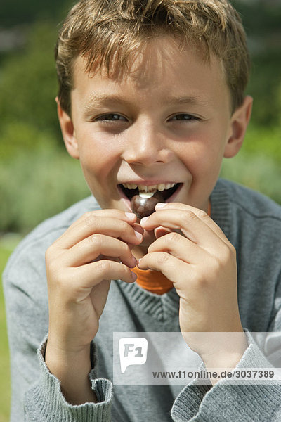 Boy eating a candy