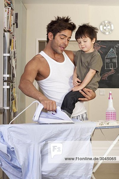 father and son ironing