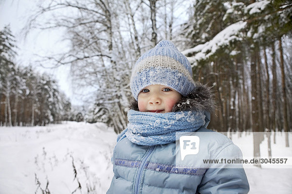 portrait of young girl in winter forest