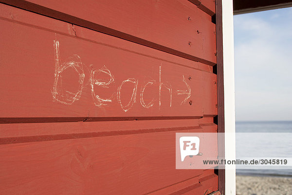 inscription on cabin leading to beach