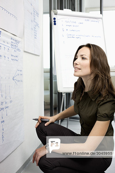 portrait of businesswoman in front of whiteboard