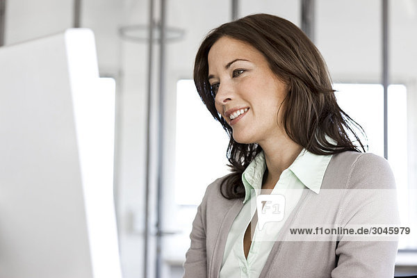 portrait of businesswoman looking at computer screen