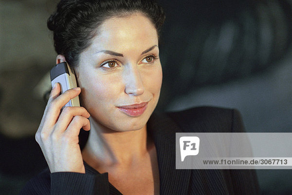 Young businesswoman using cell phone  smiling