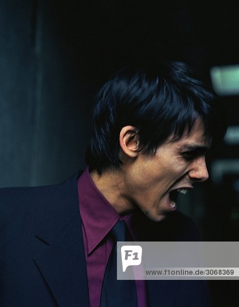 Man in suit yelling  side view