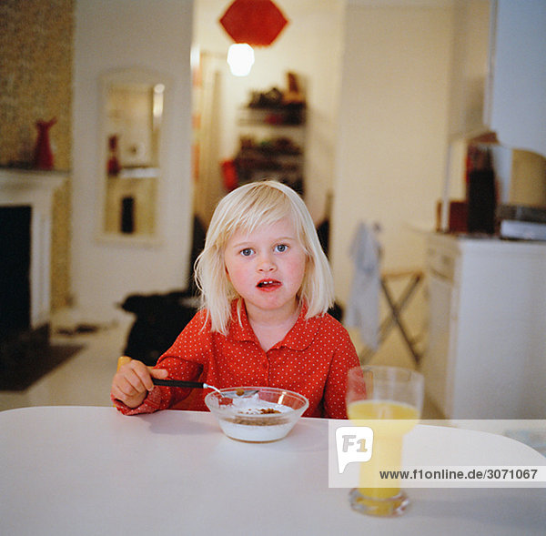 A girl having breakfast Sweden.