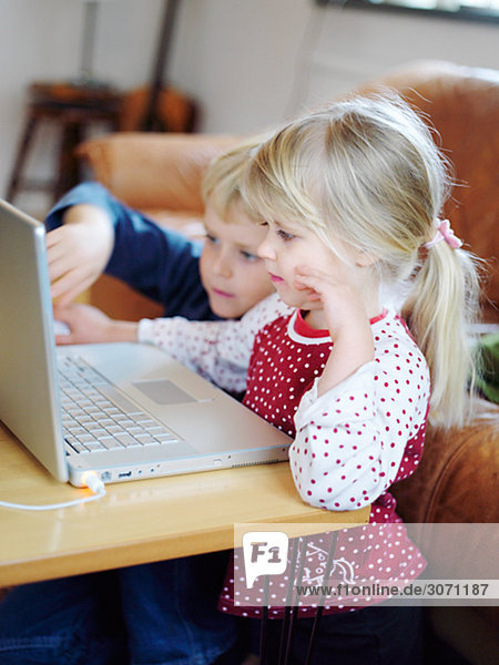 A boy and a girl in front of a computer Sweden