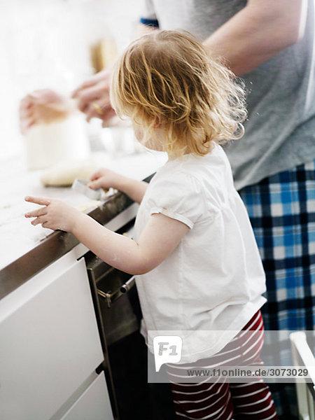 A little girl baking gingerbread Sweden