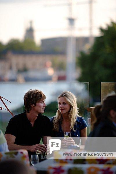 A couple at a bar Stockholm Sweden.