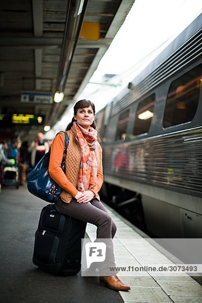 A woman at a railway station Sweden.