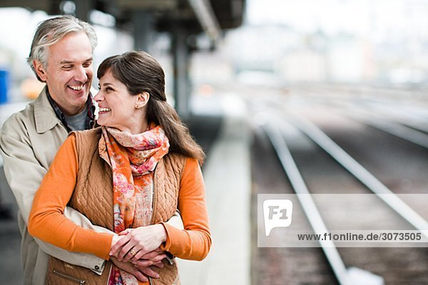 A couple at a railway station Sweden.