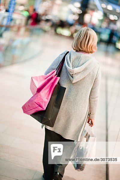 A woman carrying shopping bags Stockholm Sweden.
