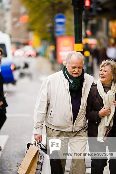 A senior couple carrying shopping bags Stockholm Sweden.
