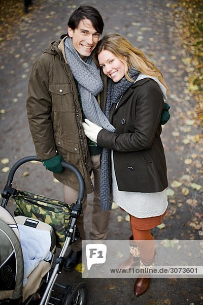 A couple taking a walk with their baby Sweden.