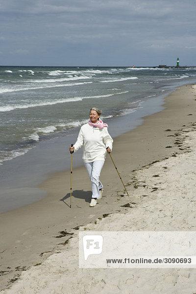 A senior woman Nordic walking