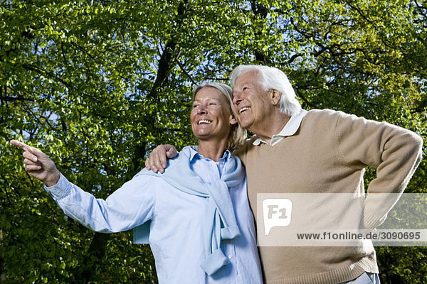 A senior couple looking away  outdoors