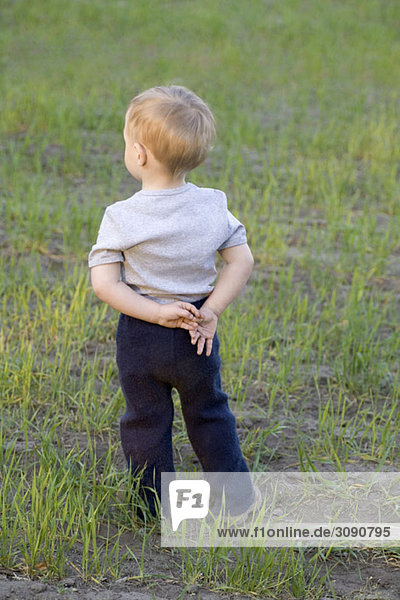 Portrait of a young boy  rear view  outdoors