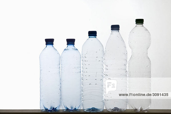 A row of plastic water bottles