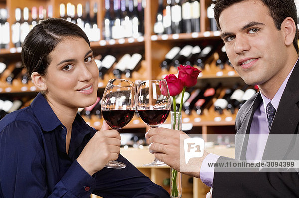 Couple toasting with wine in a bar