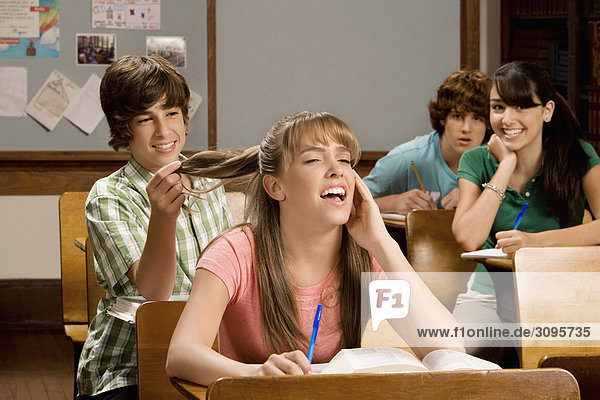 Students sitting in a classroom