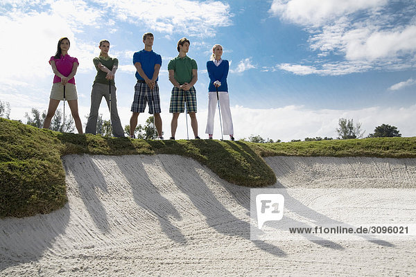 Five friends standing in a golf course  Biltmore Golf Course  Coral Gables  Florida  USA