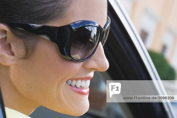 Woman smiling in a car  Biltmore Hotel  Coral Gables  Florida  USA