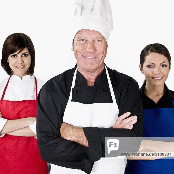 Porträt von drei Chefs lächelnd