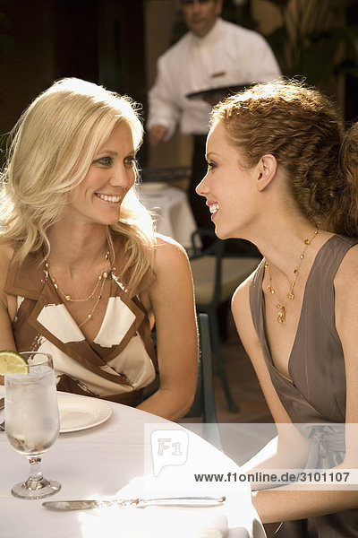 Two women smiling and having lunch in a hotel  Biltmore Hotel  Coral Gables  Florida  USA