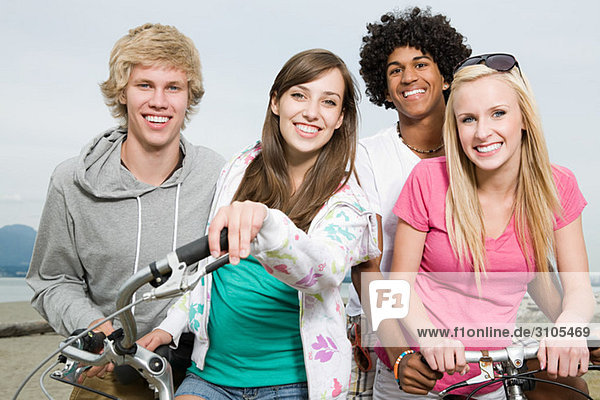 Teenagers with bicycles