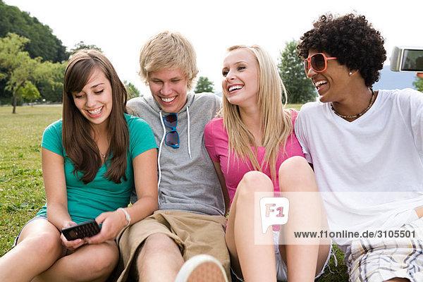 Teenage friends in park