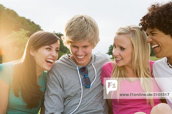 Teenage friends laughing