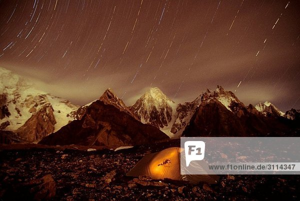 Tent and Star trail over 7000 TO 8000 meter Broad and Masherbrum in Hushe Peaks area of Karakoram Himalaya Tent and Star trail over 7000 TO 8000 meter Broad and Masherbrum in Hushe Peaks area of Karakoram Himalaya