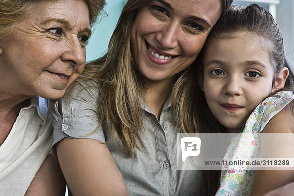 Young girl with mother and grandmother  portrait