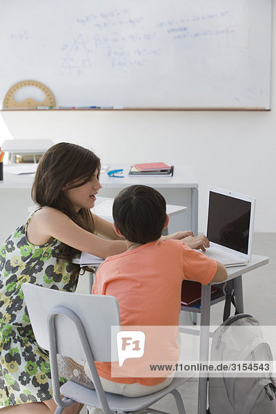 Tutor working with elementary school student