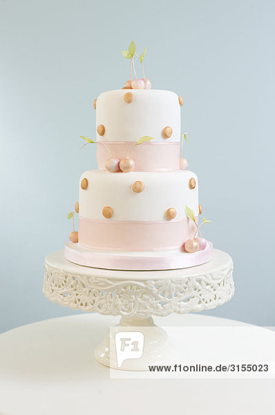 White and Pink cake with blue background