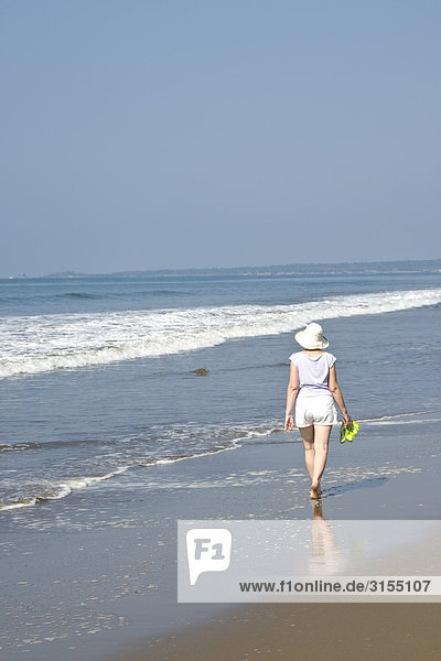 Rear view of woman walking on Beach  Mexico