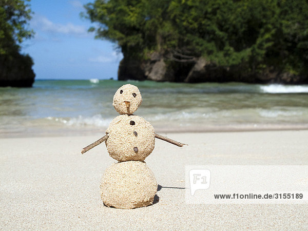 Sand figure on beach  Port Antonio  Portland  Jamaica