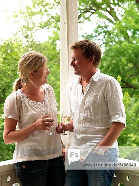 A couple in love with wine glasses in their hands Sweden.